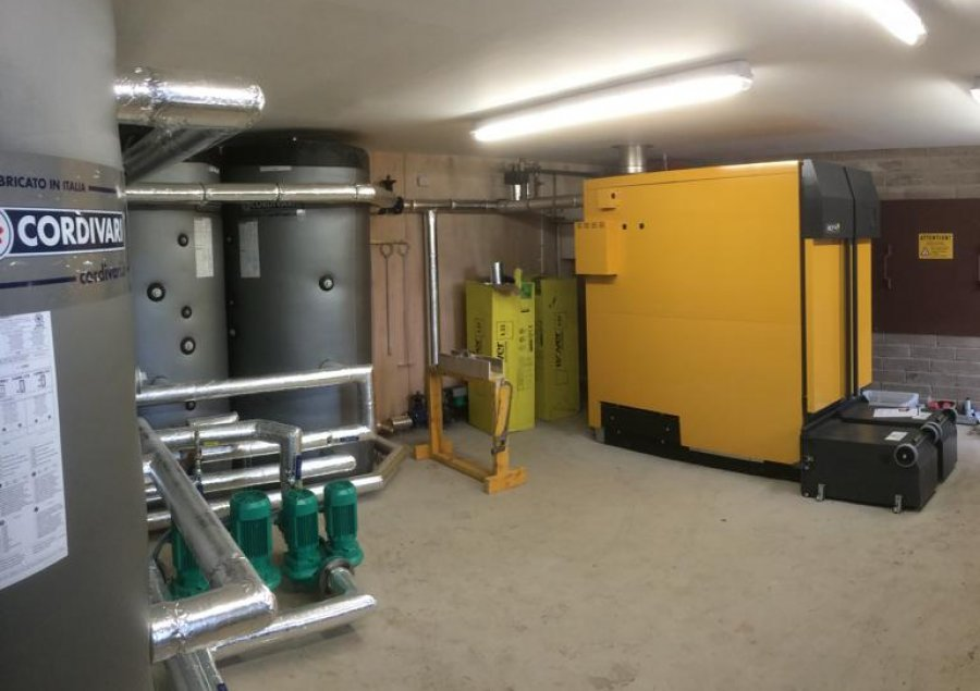 An ETA 199KW biomass boilers with 8 houses on a district heating network