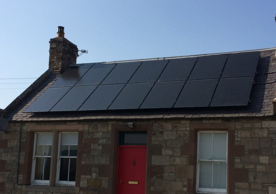 Solar PV array mounted  on an old slate roof